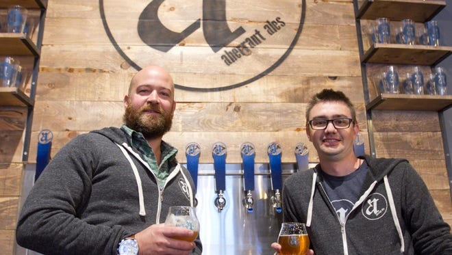 Aberrant Ales co-owner Clark Gill, left, and head brewer Adam Stout are almost ready to open the downtown Howell brewery. The soon-to-open brewery opened its doors to the Livingston Daily Thursday, Oct. 12, 2017.