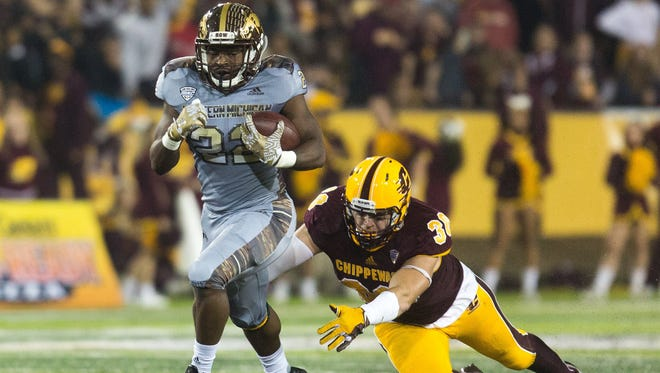 Western Michigan running back Davon Tucker (22) carries the ball as Central Michigan linebacker Alex Briones (30) attempts to tackle him during the first half of an NCAA college football game Saturday, Oct. 1, 2016, in Mount Pleasant, Mich.