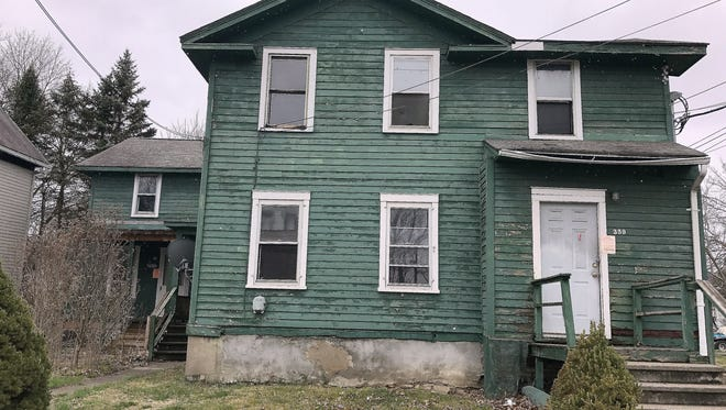 This condemned house on Columbia Street is among more than 1,200 vacant residential properties in the City of Elmira. Lack of housing is one of the biggest problems facing people mired in poverty, local officials said.