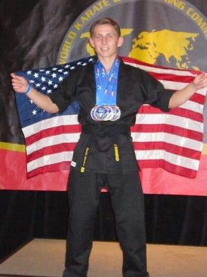 Jordan Bonenberger celebrates his gold medals at the World Kickboxing Championships in Florida.