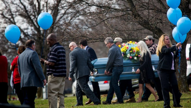 """Pallbearers carry the body of Joseph """"Joey"""" Bishop after the funeral service at Ronald B. Jones Funeral Home to Highland Cemetery in Ft. Mitchell, Ky. Thursday, February 23, 2017."""