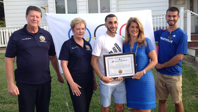 Manalapan's Robby Andrews accepts an award from Freeholder Serena DiMaso before the parade.