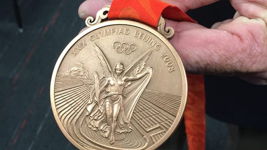 U.S. pole vaulter Derek Miles holds the Olympic Bronze
