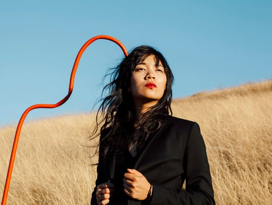 Thao Nguyen and her band Thao & the Get Down Stay Down