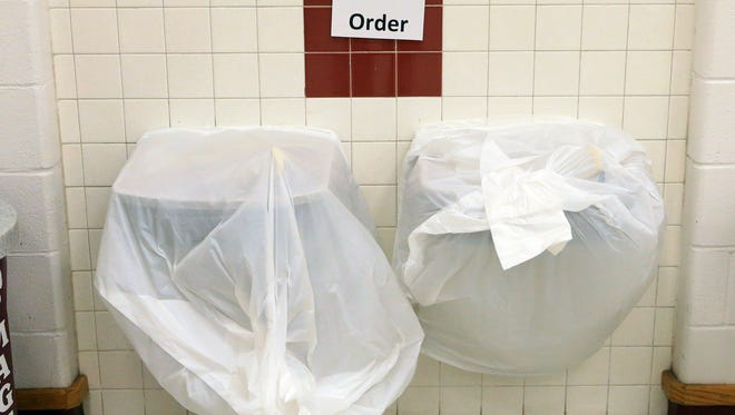 Trash bags cover water fountains at Magee Elementary School after City of Corpus Christi officials confirmed Thursday morning that one chemical contaminated the cityÕs water supply on Thursday, Dec. 15, 2016, in Corpus Christi.