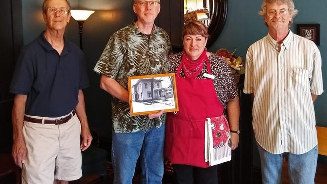 Bill and Debbie Doran open Grind On Coffee in the original Thatcher home. Pictured, from left, are Jim Weiler, Bill Doran, Debbie Doran and Chris Davis.