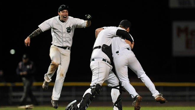 St. Johnsbury's Jake Johnson, left, celebrates the Hilltoppers' Division I baseball state championship win with catcher Jake Choiniere, center, and pitcher Eamonn McCabe on Saturday night at Centennial Field.