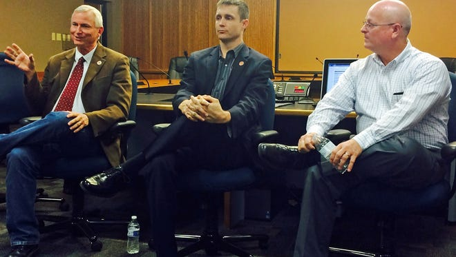 State Rep. Doug Coleman (left), state Rep. Andrew Sherwood and Mesa City Councilman Kevin Thompson talk local politics with members of Mesa Leadership.