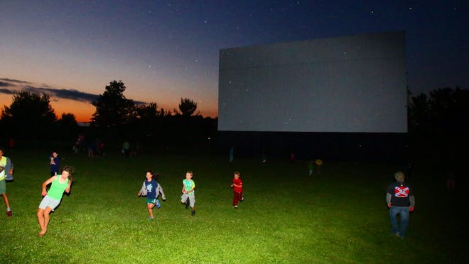 Playing in front of the screen before the movie at the Warwick Drive-in.