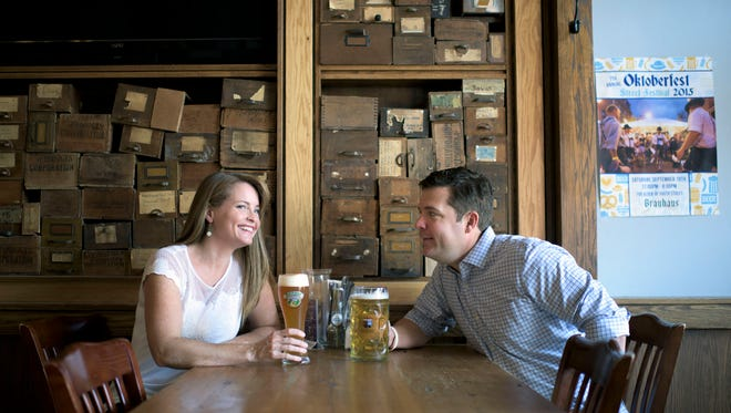 Brauhaus Schmitz owners Kelly and Doug Hager enjoy some German beer in their first restarant, located on South Street in Philadelphia.