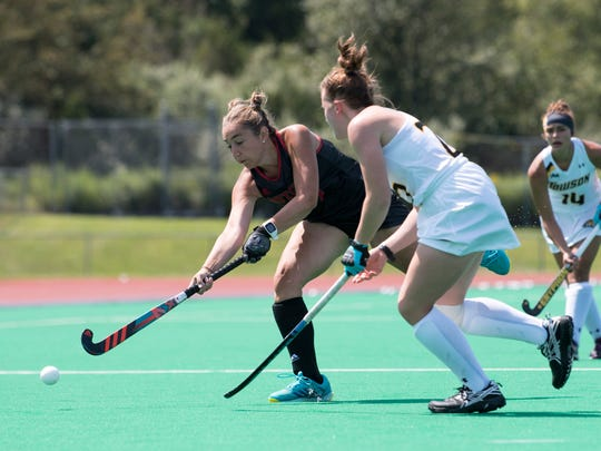 Emily Howarth (left) plays for Rutgers field hockey