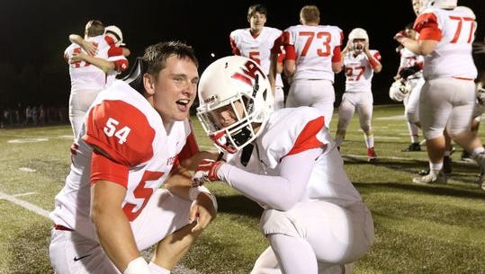 Wisconsin Rapids senior Levi Bishop celebrates Friday's overtime victory over SPASH with an unidentified teammate.