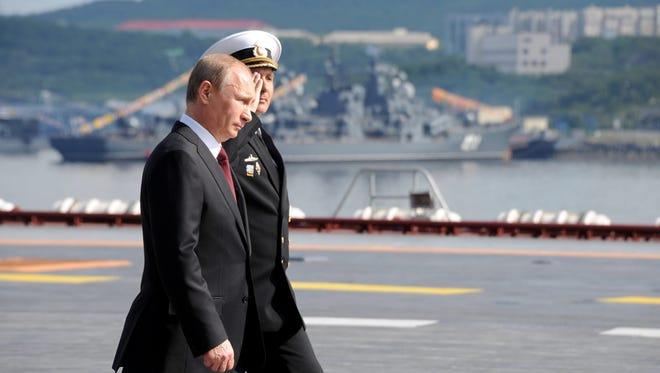 Russia's President Vladimir Putin attends  Navy Day celebrations in Severomorsk on Sunday.