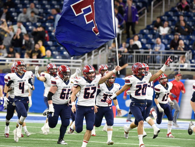Livonia Franklin players run onto Ford Field before