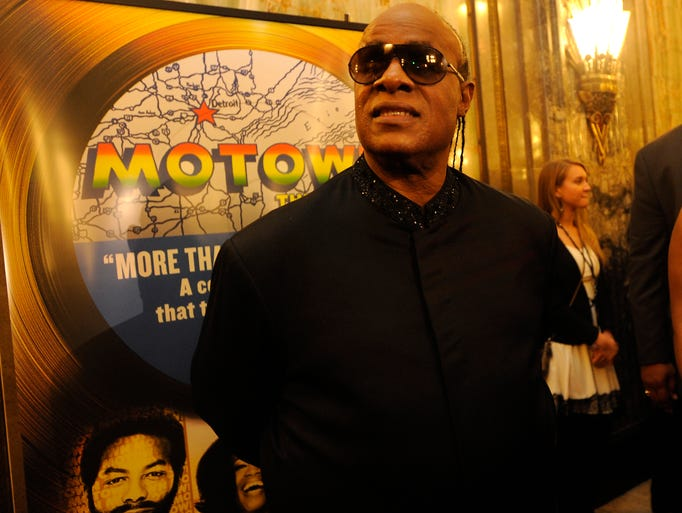 Stevie Wonder stops on the red carpet before the Detroit