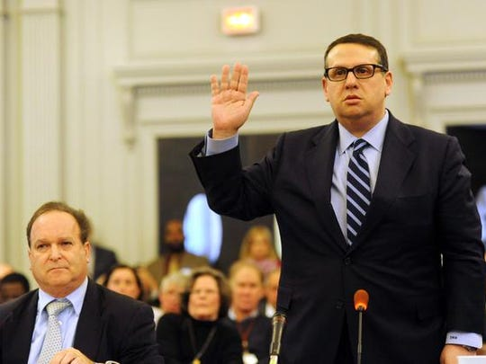 David Wildstein (right) former director of interstate capital projects for the Port Authority and his attorney Alan Zegas (left) is sworn in to testify at a hearing held by the Assembly Transportation Committee Jan. 9, 2014 in Trenton.