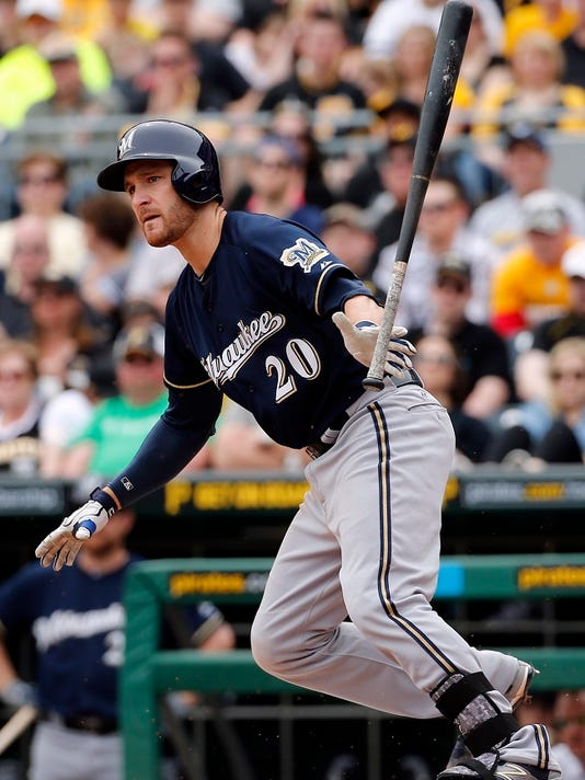 Milwaukee Brewers' Jonathan Lucroy (20) drives in a run off Pittsburgh Pirates starting pitcher Gerrit Cole in the second inning of a baseball game in Pittsburgh, Sunday, April 19, 2015.