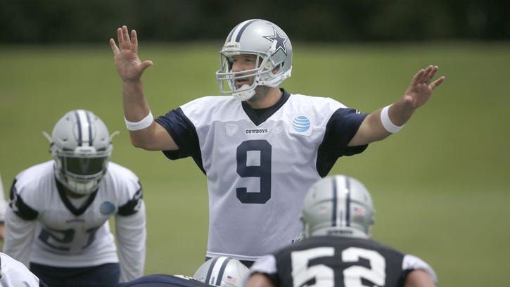 Tony Romo calls a play during a Cowboys minicamp practice this summer.