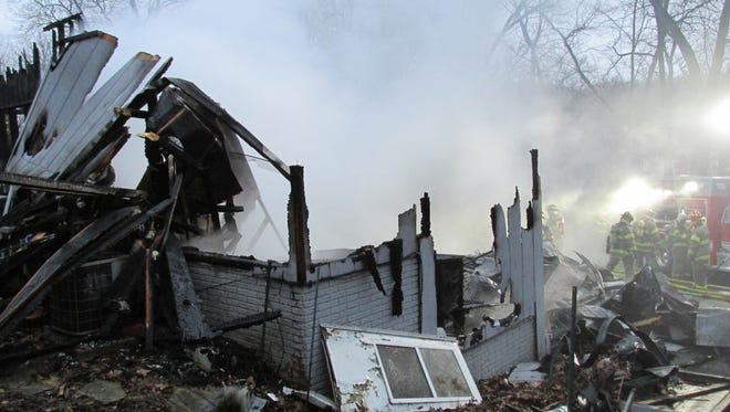 North Liberty firefighters responded early Dec. 16, 2014, to a fire that destroyed an Iowa City home.
