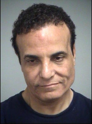Dr. Akram Ismail, charged with filiming under a woman's skirt at a Central Florida Publix
