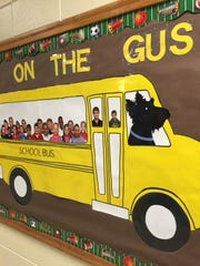 A bulletin board at Duson Elementary depicts Fergus, one of two Scottish terriers who visit the school each week.
