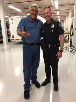 Jay Leno and Palm Bay Police Chief Mark Renkens smile wide Monday at Larsen Motorsports in Palm Bay. Leno was in town after performing a show Feb. 21 at the King Center in Melbourne.
