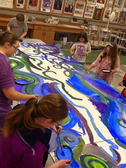 Students paint panels for a mosaic mural at the Fowlerville