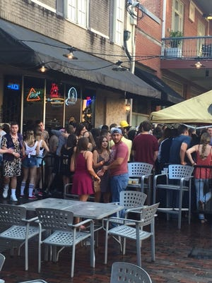 The crowds at Clyde's & Costellos often spill out onto Adams Street.