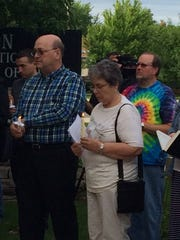 Jeff Gibson, left, and Judy Larmouth, members of Union Congregational Church, participate in a vigil on Monday, June 12, 2016.