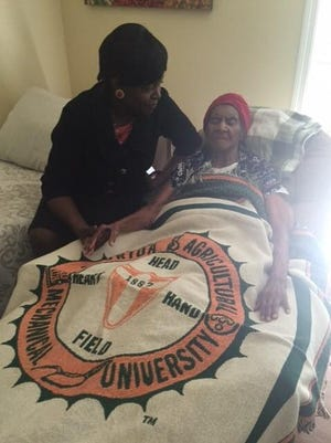 FAMU President Elmira Mangum visits with Gussie Williams Mallory earlier this month. Mrs. Mallory died July 16 at 107.