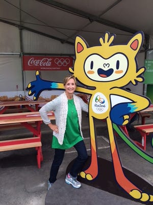 """Deborah and the Rio Mascot """"Vinicius"""" which is a blend of all the Brazilian animals"""