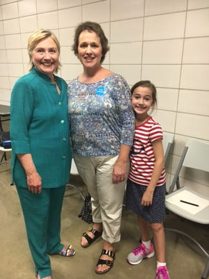 Janelle Turner and her daughter take a picture with Democratic Presidential Candidate Hillary Clinton. Turner will be a guest of Clinton's at the debate Sunday in St. Louis.
