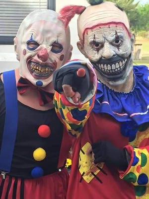 Creepy clowns get ready to scare some folks at the Whispering Pines Haunted Hayride in Milton.