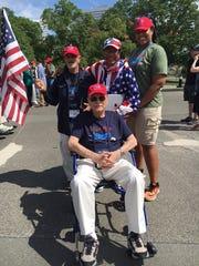 Dr. Shamsher Singh (center back) and Aleshia Johnson (back right) with Honor Flight veterans