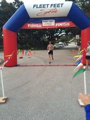 Winner Derek Stone of Stuart crosses the finish line