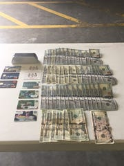 Money, gift and credit cards obtained during traffic stop of Eric Sedore on June 14, 2017, in Lee County.