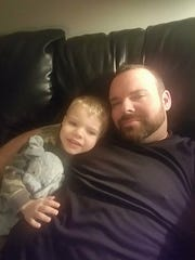 John Downey, 4, and his father Shon Downey, 40, of