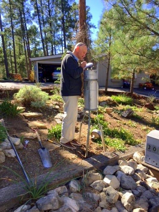 Dwight Koehn installs rain gauge
