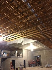 Installation of trusses and vapor barriers are the