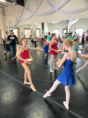 Rachel Baudo, left, carrying a drum, rehearses as a toy soldier for The Nutcracker ballet Dec. 8 and Dec. 9 at the Spencer Theater.