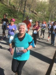 Louise Klaber runs a road race in Central Park in 2016.