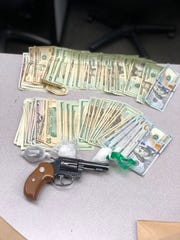 Oxnard police recovered drugs, cash and a gun during Friday's arrest.
