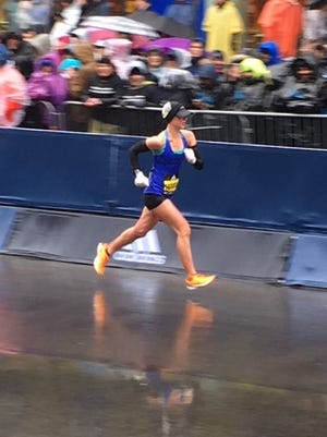 Joanna Thompson makes her way down Boylston Street near the finish line of the Boston Marathon on April 16.