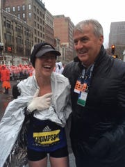 Joanna Thompson, left, talks with sports agent Ray Flynn after finishing the Boston Marathon on April 16.