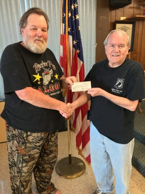 Bull Shoals American Legion Post 0341 Commander Sammy Davis, Jr., (right) presents a $1,000 check to Chuck Kinler, Commander ofBull Shoals VFW Post 1341 to go towardsupgrades on the Post's building. The VFW and American Legion, two veterans organizations, continue to work together for the betterment of our veterans and our community.Much needed building improvements are made possible by this generous donation.Many thanks to the American Legion.