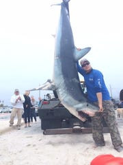 Kenny Peterson is seen with a mako shark he caught