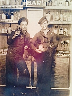 Joanne Dries, of LeRoy, matched this photo of her dad William Michals, right, with a Korean War photo to identify him in the war photo.