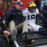 Michigan's Brandon Peters receives tests for head injury at Wisconsin