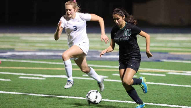 West Salem's Valeria Castro Arciga and the Titans fall to West Albany 3-2 in a Greater Valley Conference game on Tuesday, Oct. 18, 2016.