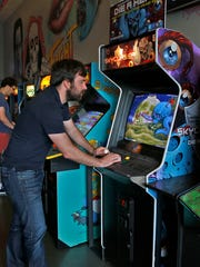 Phil Golobish plays Skycurser at Tappers Arcade Bar, Thursday, September 1, 2016.  He is one of the three people who developed the arcade game.